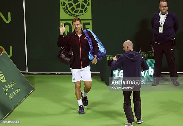 Czech player Tomas Berdych enters the pitch before the start of his match against Italy's Alessandro Giannessi on the fourth day of the ATP Qatar...