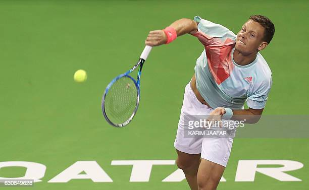 Czech player Tomas Berdych serves the ball to Italy's Alessandro Giannessi on the fourth day of the ATP Qatar Open tennis competition in Doha on...