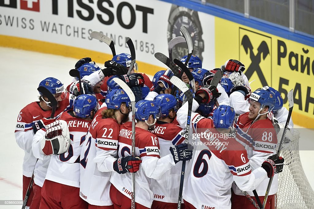 Czech players celebrate their victory against Russia during the group A preliminary round game Czech Republic vs Russia at the 2016 IIHF Ice Hockey World Championship in Moscow on May 6, 2016. / AFP / YURI