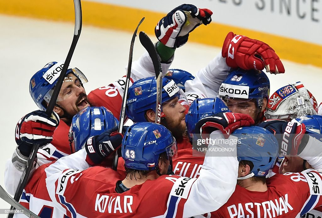 Czech players celebrate their victory over Russia during the group A preliminary round game Czech Republic vs Russia at the 2016 IIHF Ice Hockey World Championship in Moscow on May 6, 2016. / AFP / YURI