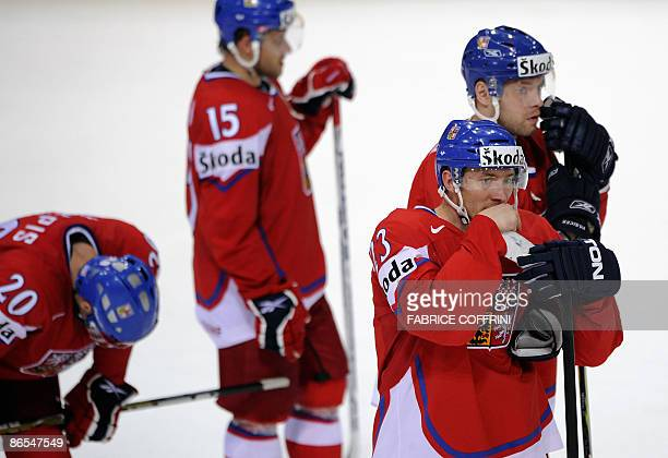 Czech players Jakub Klepis Jan Marek Karel Rachunek and Josef Vasicek react at the end of their quarterfinal game versus Sweden at the 2009 IIHF Ice...
