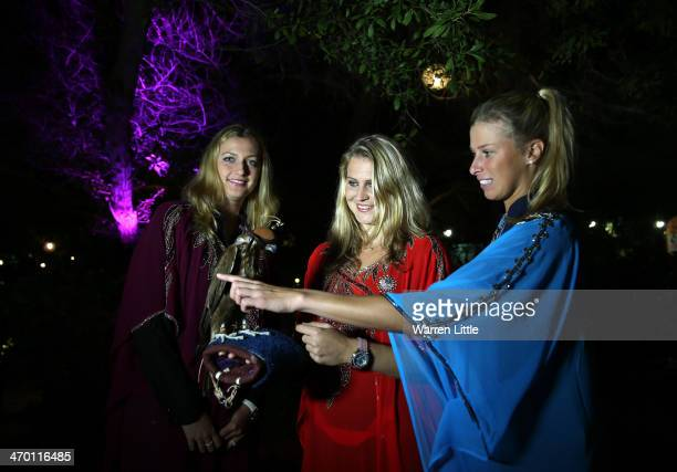 Czech players Petra Kvitova Lucie Safarova and Andrea Hlavackova pose with a falcon dressed in tradiional local dress during the players party on day...