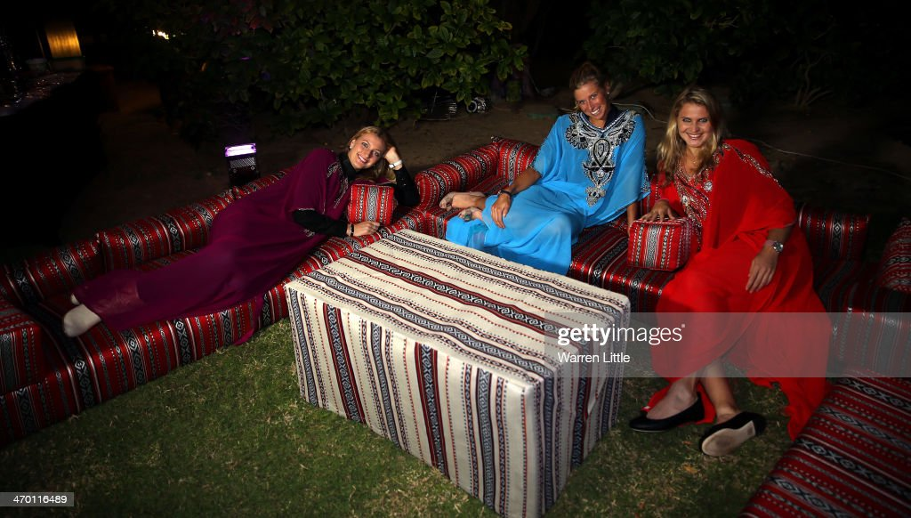 Czech players, Petra Kvitova, Lucie Safarova and <a gi-track='captionPersonalityLinkClicked' href=/galleries/search?phrase=Andrea+Hlavackova&family=editorial&specificpeople=3378910 ng-click='$event.stopPropagation()'>Andrea Hlavackova</a> pose with a falcon dressed in tradiional local dress during the players party on day two of the WTA Dubai Duty Free Tennis Championship at the Dubai Tennis Stadium on February 18, 2014 in Dubai, United Arab Emirates.