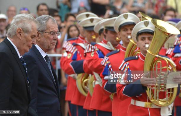 Czech President Milos Zeman and his Austrian counterpart Alexander Van der Bellen review a guard of honor on June 27 2017 prior a meeting at the...