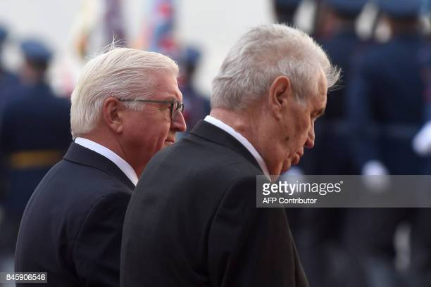 Czech President Milos Zeman and his German counterpart FrankWalter Steinmeier review a guard of honor on September 12 2017 at the start of their...