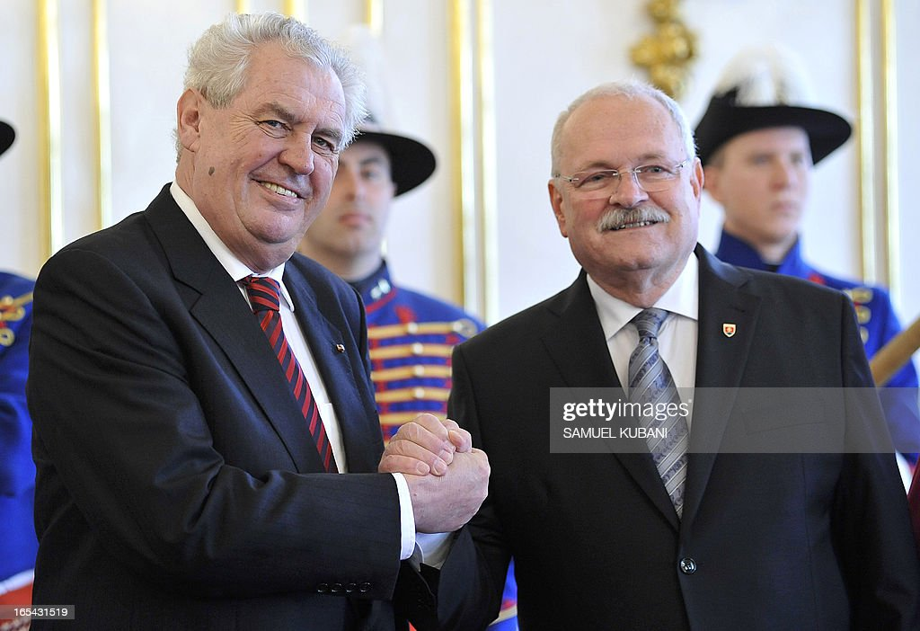 Czech President Milos Zeman (L) and his Slovak counterpart Ivan Gasparovic shake hands on April 4, 2013 during their official meeting in Bratislava. New elected Czech President Milos Zeman is on his first official two-day visit to Slovakia.
