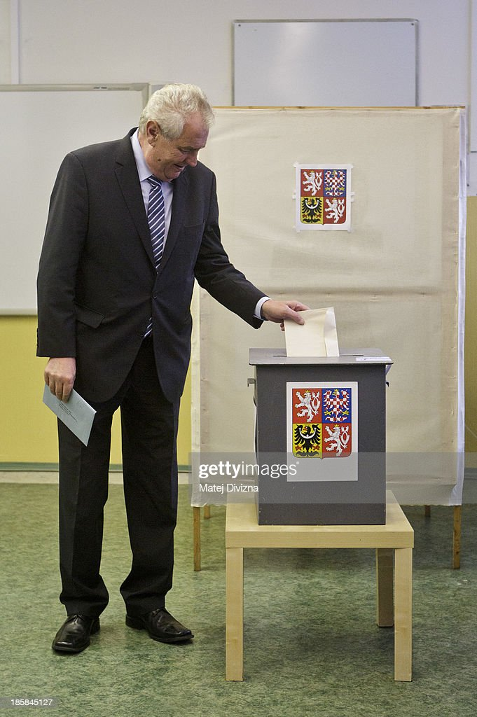 Czech President <a gi-track='captionPersonalityLinkClicked' href=/galleries/search?phrase=Milos+Zeman&family=editorial&specificpeople=2595776 ng-click='$event.stopPropagation()'>Milos Zeman</a> casts his ballot during the first day of the Czech early election on October 25, 2013 in Prague, Czech Republic. This early election is being held due to the resignation of former Prime Minister Petr Necas following a corruption scandal involving his chief-of-staff in June 2013. Eight million Czech citizens are expected to turn out to vote for 23 parties and movements across the country.