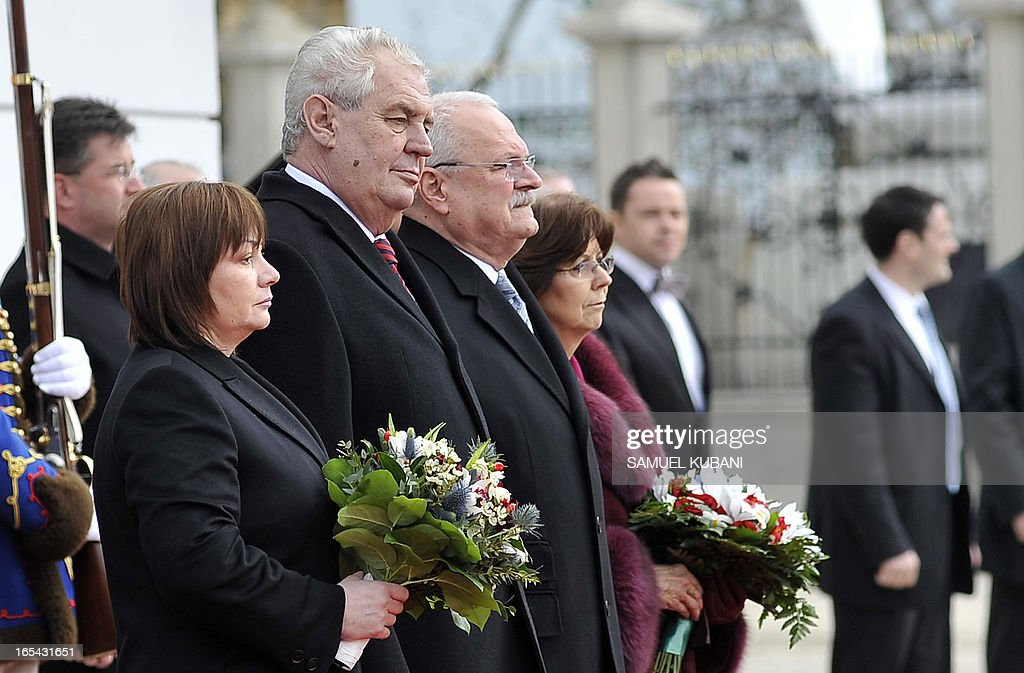 Czech President Milos Zeman (2nd L), his wife Ivana Zemanova (L) and Slovak counterpart Ivan Gasparovic (3rd L) and his wife Silvia Gasparovic (R) inspect a honor guard during their official meeting in Bratislava on April 4, 2013. New elected Czech President Milos Zeman is on his first official two-day visit to Slovakia.