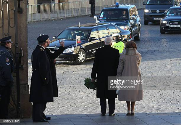 Czech President Vaclav Claus and his wife Livia Rosamunda Clausova greet Russian President Dmitry Medvedev's car during a visit to the city on...