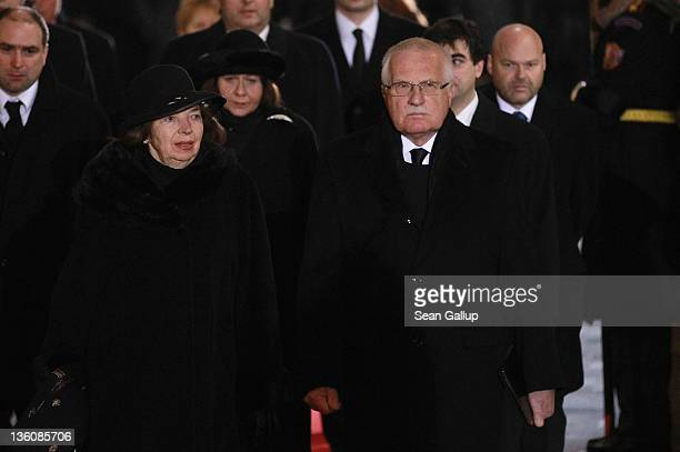 Czech President Vaclav Klaus and his wife Livia Klausova arrive for the state funeral of former Czech President Vaclav Havel at St Vitus Cathedral on...