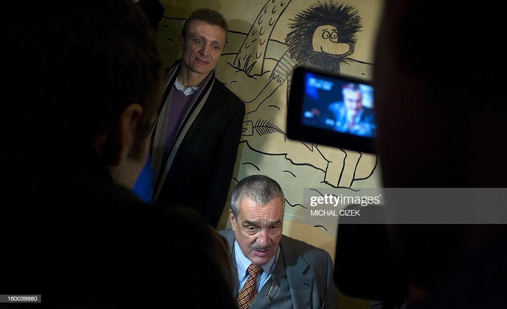 Czech presidential candidate Karel Schwarzenberg speaks to journalists after casting his ballot during the second round of the first direct Czech presidential election on January 25, 2013 in Sykorice village, 50km from Prague. Czechs went to the polls to choose a new president between a former communist and a 75-year-old aristocrat whose Sex Pistols-inspired campaign brought the election to life and down to the wire.