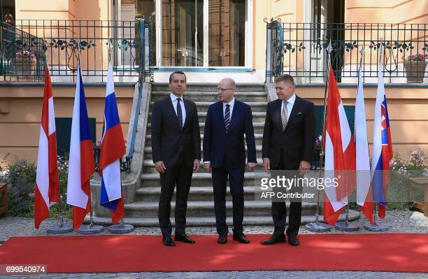 Czech Prime Minister Bohuslav Sobotka is flanked by Slovak Prime Minister Robert Fico and Austrian Chancellor Christian Kern as they pose for a...