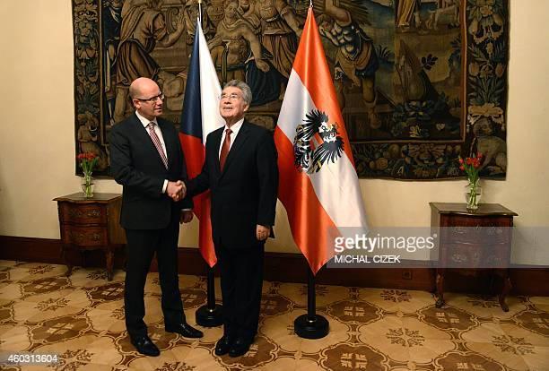 Czech Prime Minister Bohuslav Sobotka shakes hand with Austrian President Heinz Fischer before their meeting on December 11 2014 in Prague AFP...