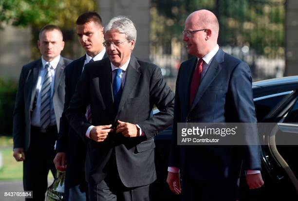 Czech Prime Minister Bohuslav Sobotka welcomes his Italian counterpart Paolo Gentiloni before their meeting on September 07 2017 in Prague / AFP...