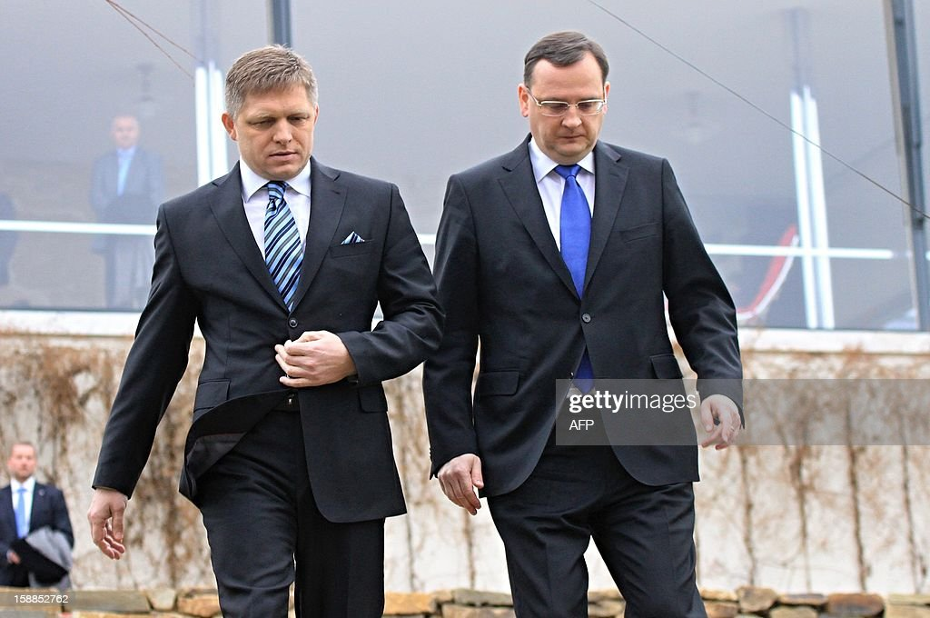 Czech Prime Minister Petr Necas (R) and his Slovak counterpart Robert Fico walk on January 1, 2013 at Villa Tugendhat in Brno where former premiers Klaus and Meciar agreed 20 years ago to the division of Czechoslovakia. Czechoslovakia, founded in 1918 after World War I brought down the Austro-Hungarian empire, split on January 1, 1993, just over three years after shedding its four-decade Communist regime.