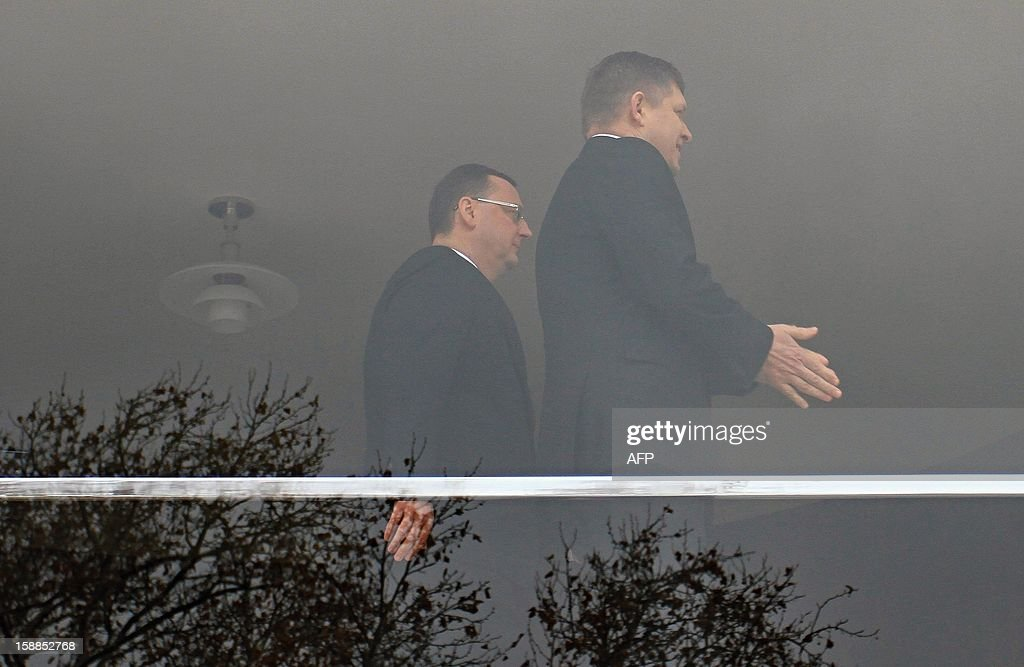 Czech Prime Minister Petr Necas (L) and his Slovak counterpart Robert Fico walk on January 1, 2013 at Villa Tugendhat in Brno where former premiers Klaus and Meciar agreed 20 years ago to the division of Czechoslovakia. Czechoslovakia, founded in 1918 after World War I brought down the Austro-Hungarian empire, split on January 1, 1993, just over three years after shedding its four-decade Communist regime. AFP PHOTO/ RADEK MICA