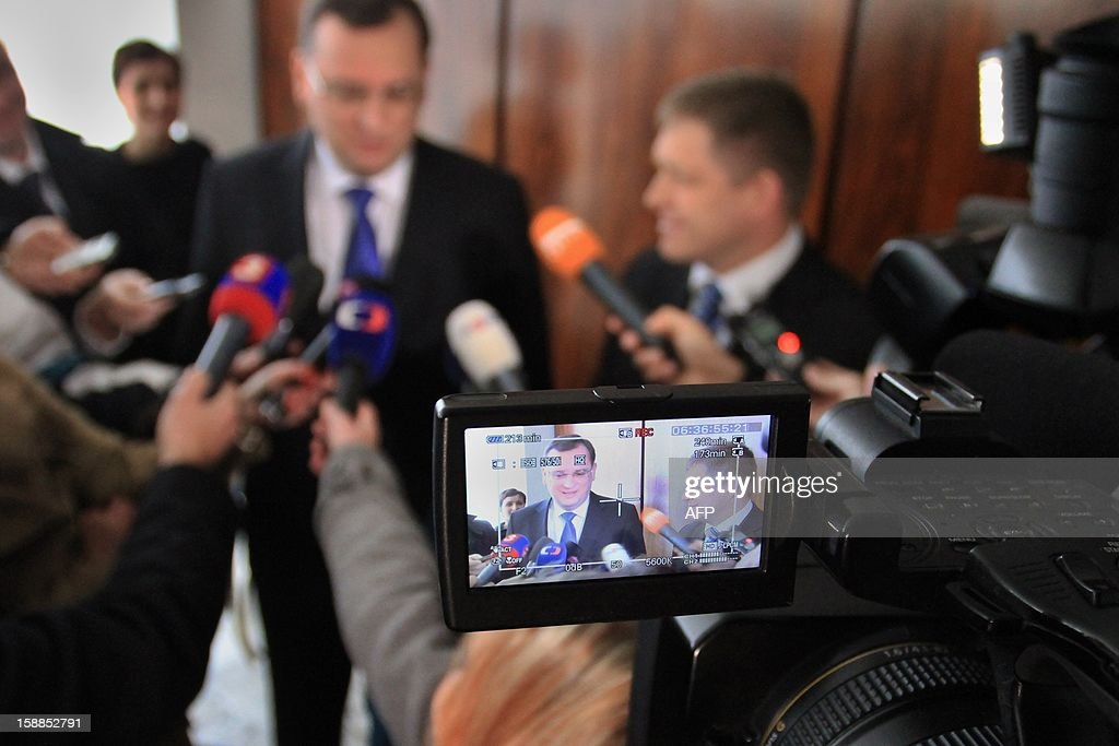 Czech Prime Minister Petr Necas (L) and his Slovak counterpart Robert Fico are seen in a camera screen during a meeting in Brno on the 20th anniversary of the establishment of Czech Republic and Slovak Republic. Czechoslovakia, founded in 1918 after World War I brought down the Austro-Hungarian empire, split on January 1, 1993, just over three years after shedding its four-decade Communist regime. AFP PHOTO/ RADEK MICA