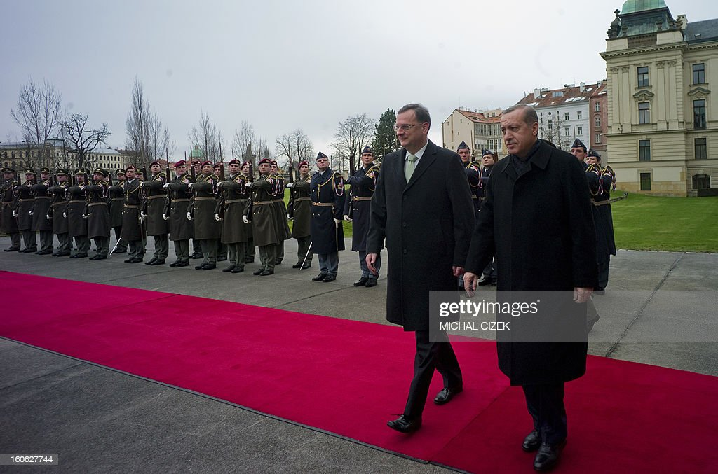 Czech Prime Minister Petr Necas (L) and Turkish Prime Minister Recep Tayyip Erdogan review a guard of honour during a welcoming ceremony on February 4, 2013 at the government headquarter in Prague. AFP PHOTO / MICHAL CIZEK