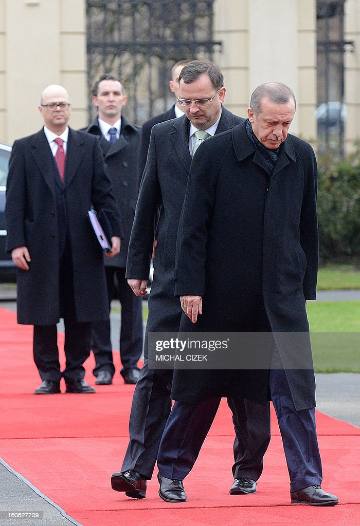 Czech Prime Minister Petr Necas (L) and Turkish Prime Minister Recep Tayyip Erdogan prepare to review a guard of honour during a welcoming ceremony before their meeting on February 04, 2013 at the government headquarter in Prague. CIZEK