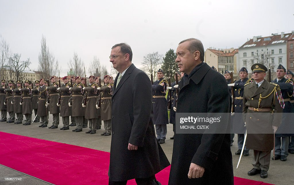 Czech Prime Minister Petr Necas (L) and Turkish Prime Minister Recep Tayyip Erdogan leave after reviewing a guard of honour during a welcoming ceremony before their meeting on February 04, 2013 at the government headquarter in Prague. CIZEK