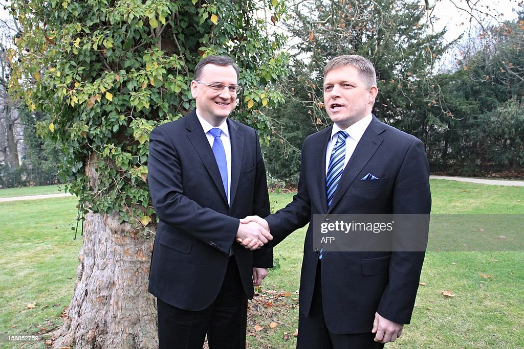 Czech Prime Minister Petr Necas (L) shakes hands with Slovak counterpart Robert Fico in Brno on the 20th anniversary of the establishment of Czech Republic and Slovak Republic. Czechoslovakia, founded in 1918 after World War I brought down the Austro-Hungarian empire, split on January 1, 1993, just over three years after shedding its four-decade Communist regime.