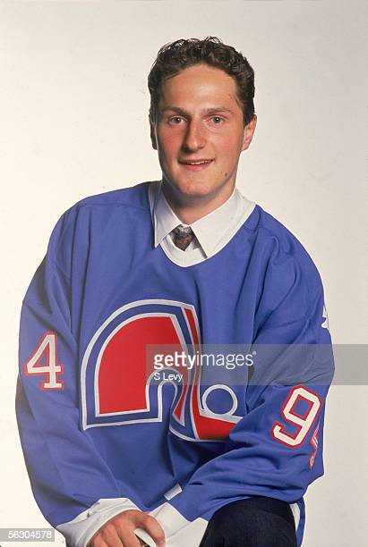 Czech professional hockey player Milan Hejduk poses in a new team jersey after he was drafted by the Quebec Nordiques at the 1994 NHL entry draft...