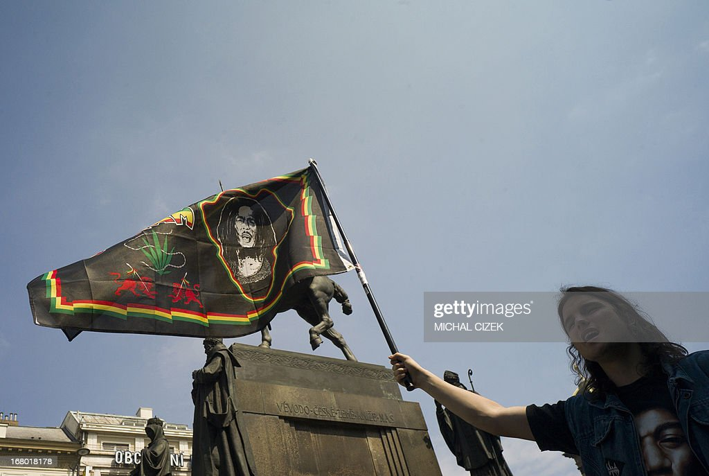 A Czech protester holds up a Bob Marley flag in front of the Saint Venceslas Statue as he takes part in a demonstration for the legalization of marijuana, in Prague on May 4, 2013. AFP PHOTO / MICHAL CIZEK