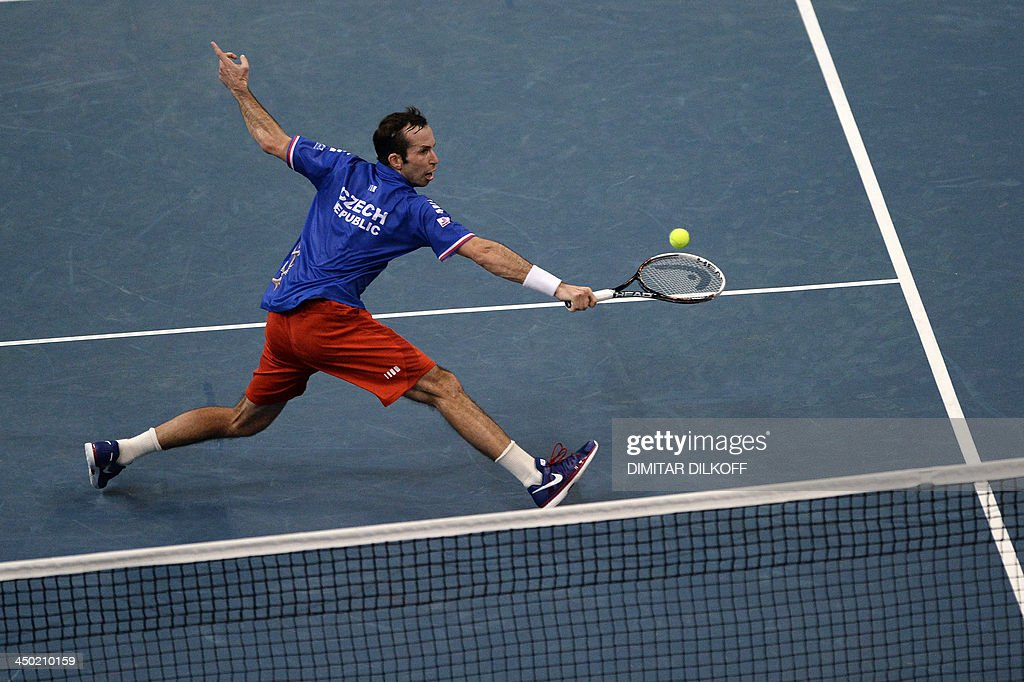 Czech Radek Stepanek returns the ball to Serbian Dusan Lajovic during the Davis Cup final between Serbia and the Czech Republic at the Kombank Arena in Belgrade on November 17, 2013.