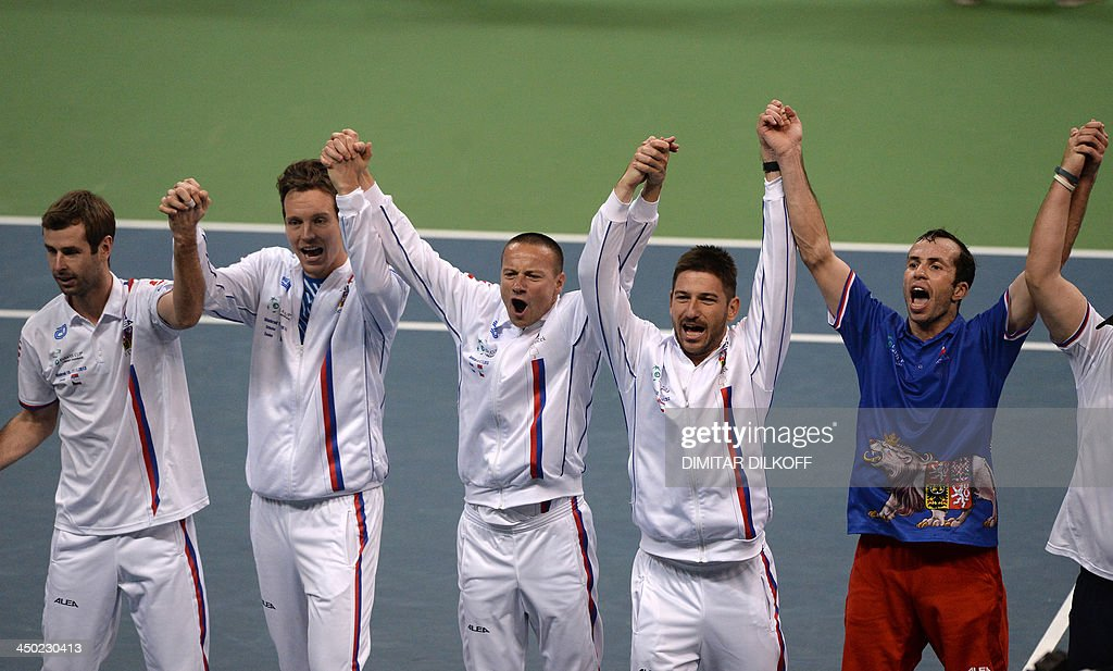 Czech Rebublic's Radek Stepanek (R) and teammates celebrate after winning the Davis Cup final between Serbia and the Czech Republic at the Kombank Arena in Belgrade on November 17, 2013. The Czech Republic defended the Davis Cup title after Radek Stepanek beat Serbian youngster Dusan Lajovic in the decisive fifth final rubber in straight sets on November 17, 2013.