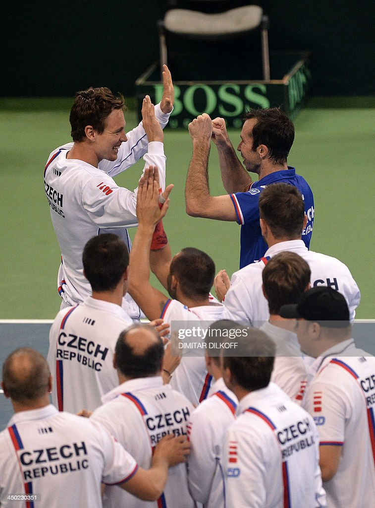Czech Rebublic's Radek Stepanek (R) and Tomas Berdych celebrate with teammates after winning the Davis Cup final between Serbia and the Czech Republic at the Kombank Arena in Belgrade on November 17, 2013. The Czech Republic defended the Davis Cup title after Radek Stepanek beat Serbian youngster Dusan Lajovic in the decisive fifth final rubber in straight sets on November 17, 2013.