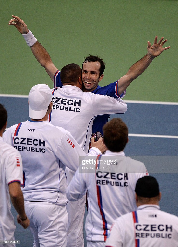 Czech Rebublic's Radek Stepanek celebrates with teammates after winning against Serbia's Dusan Lajovic during the Davis Cup final between Serbia and the Czech Republic at the Kombank Arena in Belgrade on November 17, 2013. The Czech Republic defended the Davis Cup title after Radek Stepanek beat Serbian youngster Dusan Lajovic in the decisive fifth final rubber in straight sets on November 17, 2013. AFP PHOTO / DIMITAR DILKOFF
