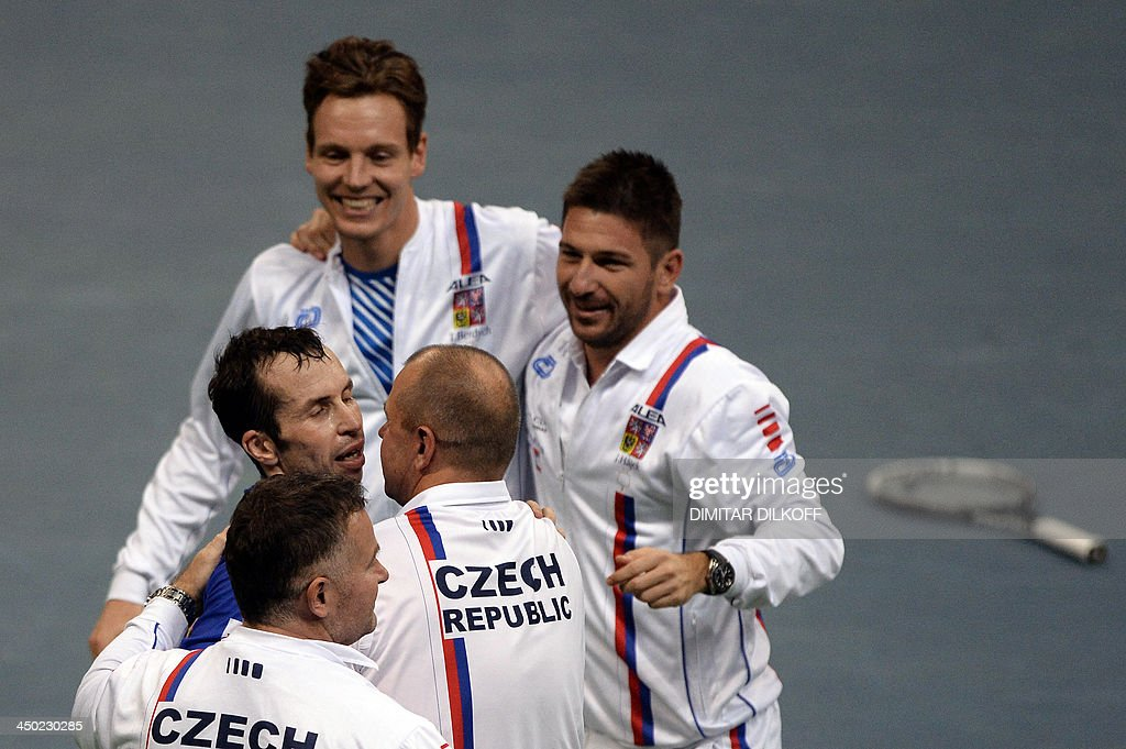 Czech Rebublic's Radek Stepanek (L) celebrates with teammates after winning against Serbia's Dusan Lajovic during the Davis Cup final between Serbia and the Czech Republic at the Kombank Arena in Belgrade on November 17, 2013. The Czech Republic defended the Davis Cup title after Radek Stepanek beat Serbian youngster Dusan Lajovic in the decisive fifth final rubber in straight sets on November 17, 2013.