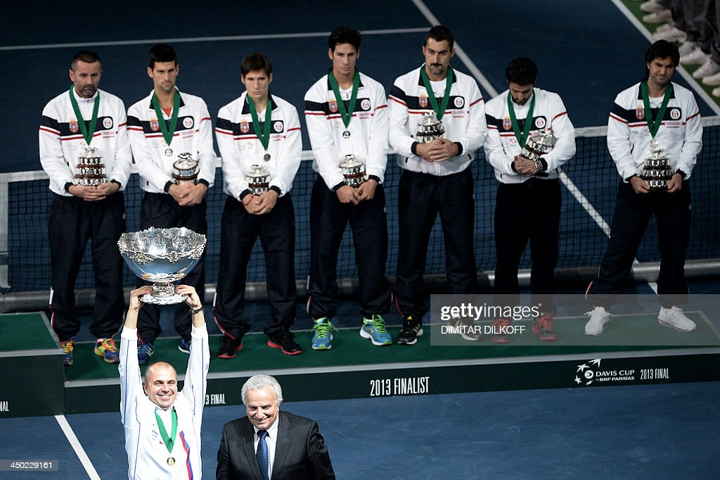 Czech Rebublic's team captain Vladimir Safarik (L) holds up the Davis Cup after winning the last singles Davis Cup tennis match finals between Czech Rebublic and Serbia at the Kombank Arena in Belgrade on November 17, 2013. The Czech Republic defended the Davis Cup title after Radek Stepanek beat Serbian youngster Dusan Lajovic in the decisive fifth final rubber in straight sets on November 17, 2013.