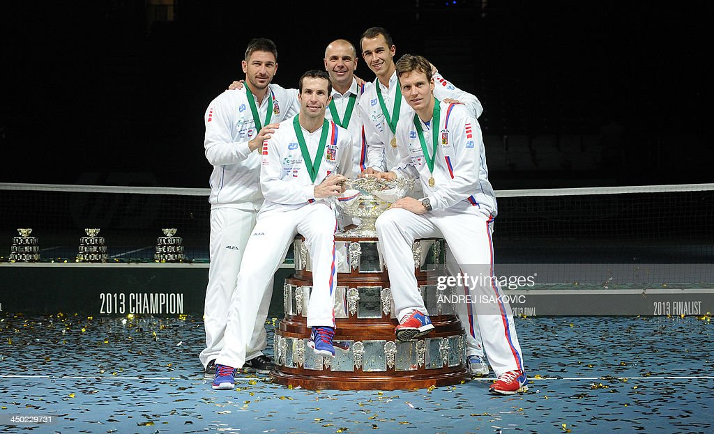 Czech Rebublic's team members celebrate with the Davis Cup after winning the last singles Davis Cup tennis match finals between Czech Rebublic and Serbia at the Kombank Arena in Belgrade on November 17, 2013. The Czech Republic defended the Davis Cup title after Radek Stepanek beat Serbian youngster Dusan Lajovic in the decisive fifth final rubber in straight sets on November 17, 2013. AFP PHOTO / ANDREJ ISAKOVIC