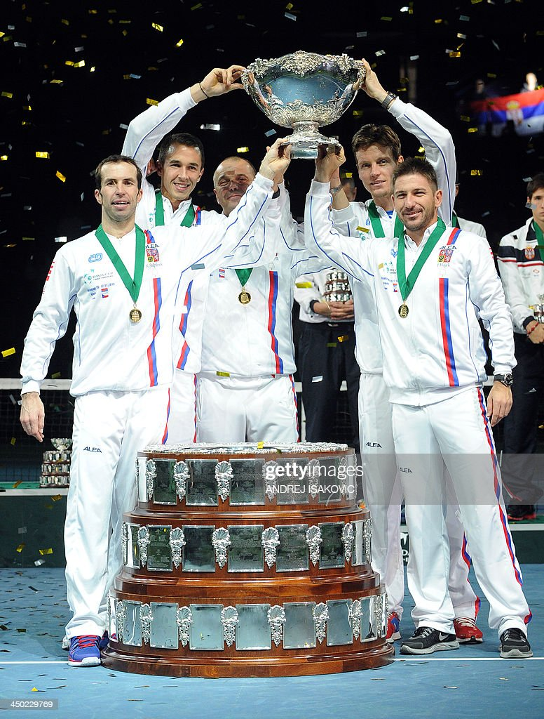 Czech Rebublic's team members hold the Davis Cup after winning the last singles Davis Cup tennis match finals between Czech Rebublic and Serbia at the Kombank Arena in Belgrade on November 17, 2013. The Czech Republic defended the Davis Cup title after Radek Stepanek beat Serbian youngster Dusan Lajovic in the decisive fifth final rubber in straight sets on November 17, 2013.
