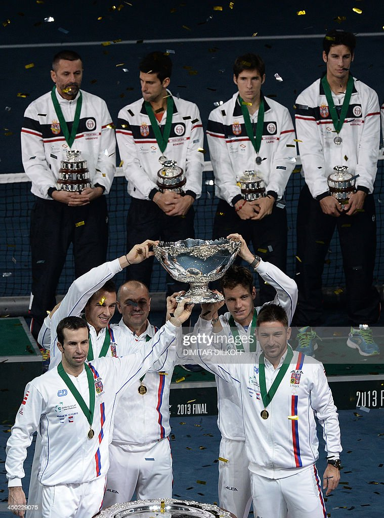 Czech Rebublic's team members (front) hold up the Davis Cup after winning the last singles Davis Cup tennis match finals between Czech Rebublic and Serbia at the Kombank Arena in Belgrade on November 17, 2013. The Czech Republic defended the Davis Cup title after Radek Stepanek beat Serbian youngster Dusan Lajovic in the decisive fifth final rubber in straight sets on November 17, 2013.