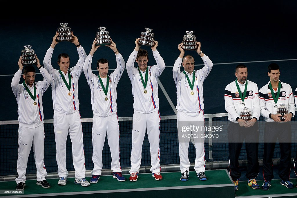 Czech Rebublic's team members hold up trophies after winning after winning the Davis Cup tennis match finals against Serbia at the Kombank Arena in Belgrade on November 17, 2013. The Czech Republic defended the Davis Cup title after Radek Stepanek beat Serbian youngster Dusan Lajovic in the decisive fifth final rubber in straight sets on November 17, 2013.
