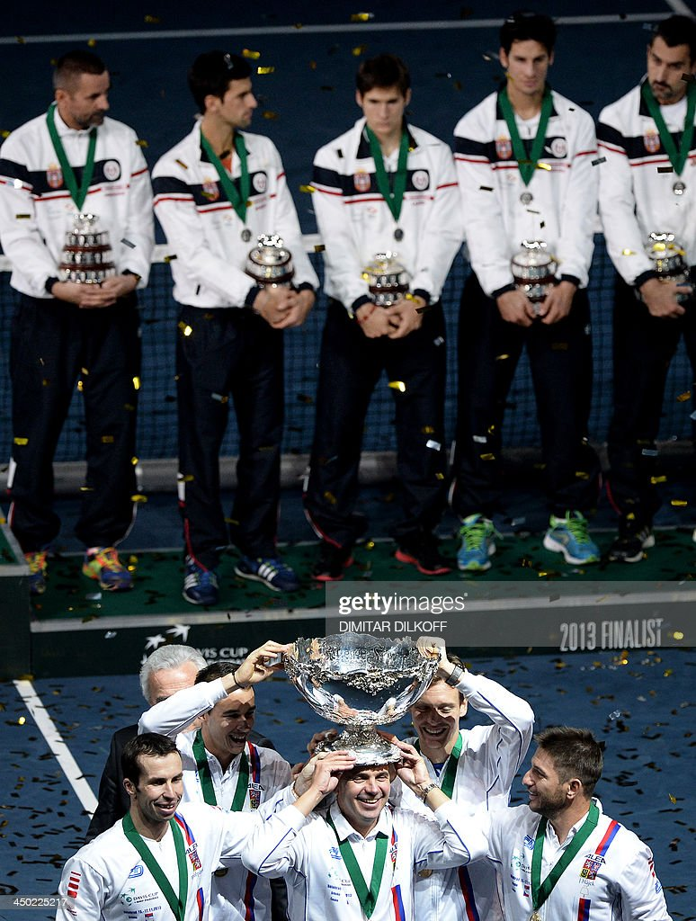 Czech Rebublic's team members (front) play with the Davis Cup after winning the last singles Davis Cup tennis match finals between Czech Rebublic and Serbia at the Kombank Arena in Belgrade on November 17, 2013. The Czech Republic defended the Davis Cup title after Radek Stepanek beat Serbian youngster Dusan Lajovic in the decisive fifth final rubber in straight sets on November 17, 2013.