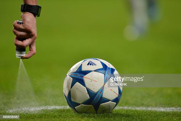 Czech referee Pavel Kralovev sprays the free kick line during a UEFA Chamions league group stage football match between Chelsea and Dynamo Kiev at...