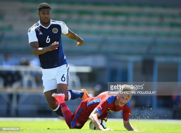 Czech' Republic forward Martin Graiciar vies with Scotland's defender Zak Jules during the Under 21 international football third place match Czech...