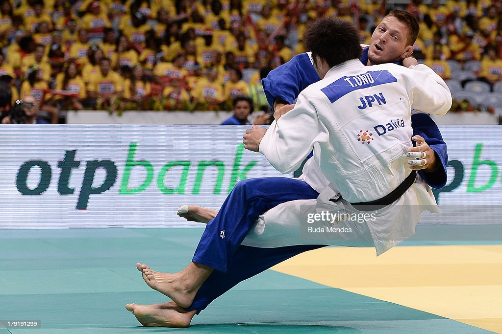 Czech Republic judoka Lukas Krpalek (blue) competes with Japan's Takashi Ono during the -100kg category medal Bronze of the IJF World Judo Championship at Gymnasium Maracanazinho on August 31, 2013 in Rio de Janeiro, Brazil.