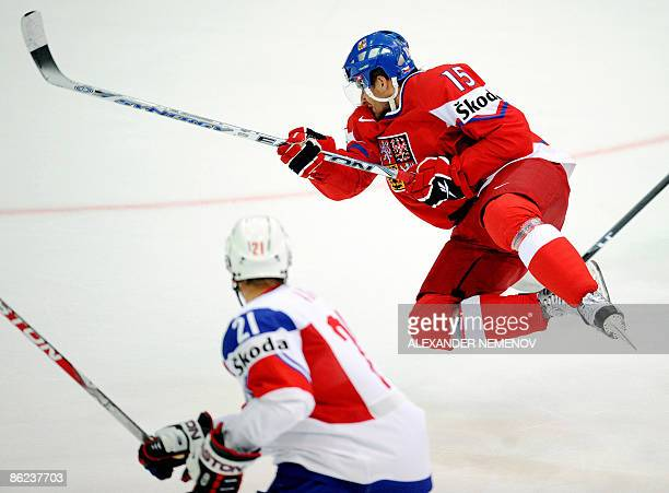 Czech Republic player Jan Marek flies past Norway's Morten Ask during a preliminary round group D game of the IIHF Internetional Ice Hockey World...