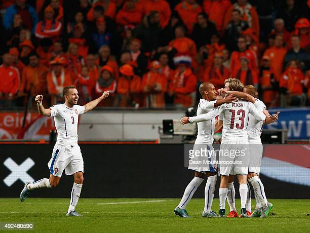 Czech Republic players celebrate as Robin van Persie of the Netherlands scores an own goal for the Czech Republic's third during the UEFA EURO 2016...