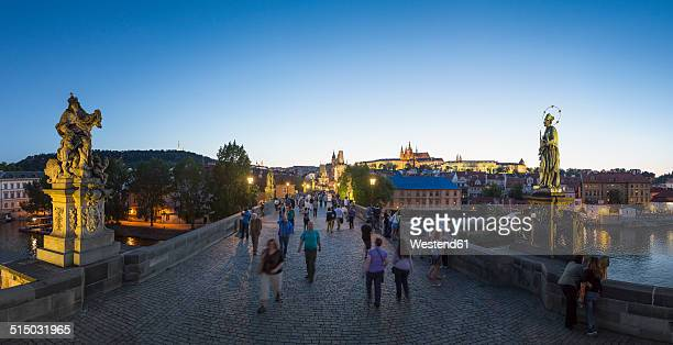Czech Republic, Prague, People on Charles Bridge in the evening twilight