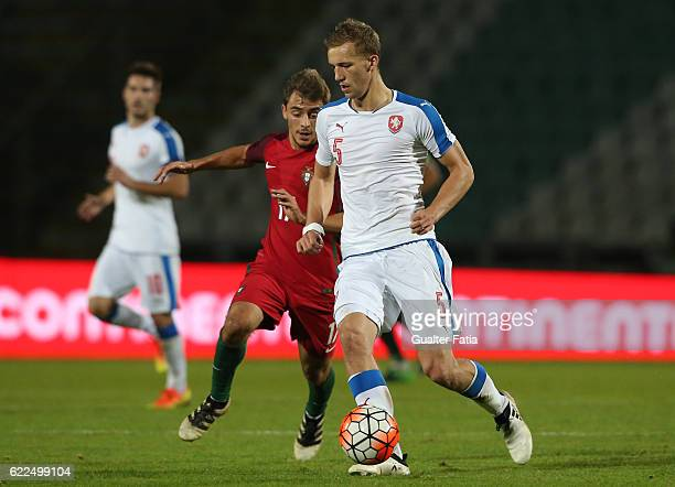 Czech Republic's defender Tomas Soucek with Portugal's midfielder Francisco Geraldes in action during U21 Friendly match between Portugal and Czech...