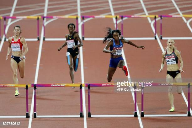 Czech Republic's Denisa Rosolova Jamaica's Rhonda Whyte US athlete Dalilah Muhammad and Canada's Sage Watson compete in a semifinal of the women's...