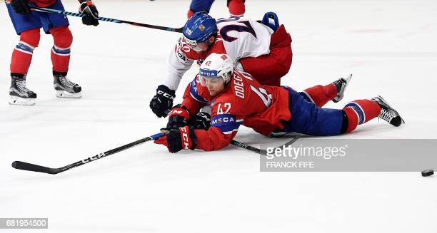 Czech Republic's forward Petr Vrana vies with Norway's defender Henrik Odegaard during the IIHF Men's World Championship group B ice hockey match...