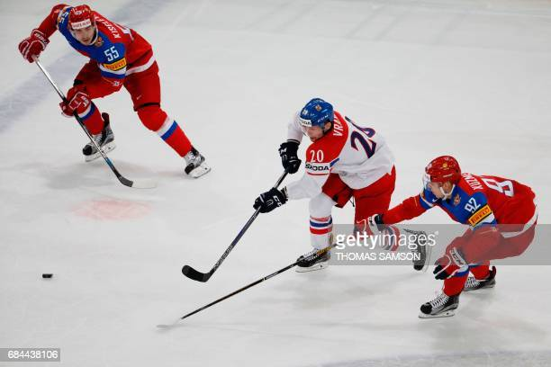 TOPSHOT Czech Republic's forward Petr Vrana vies with Russia's forward Yevgeni Kuznetsov during the IIHF Men's World Championship quarter final ice...