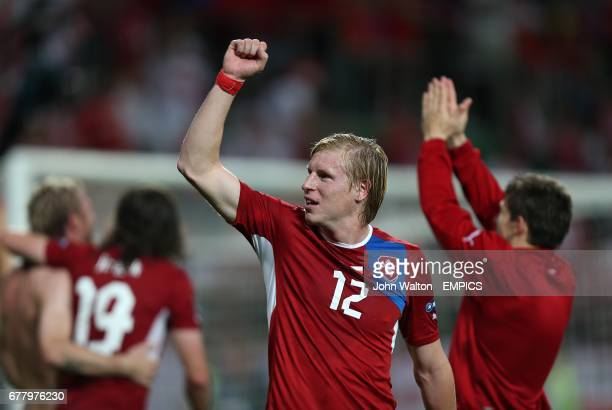 Czech Republic's Frantisek Rajtoral celebrates victory with teammates after the final whistle