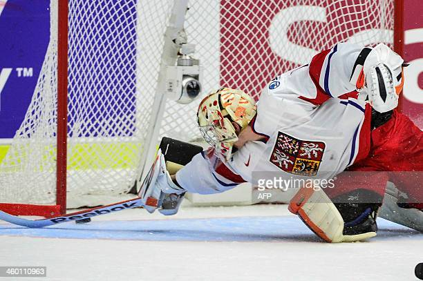 Czech Republic's goalie Marek Langhamer stretches in vain to reach the puck that makes 23 during the World Junior Hockey Championships quarter final...